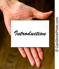 """Introduction - Hand holding an """"Introduction"""" note. Ideal to..."""