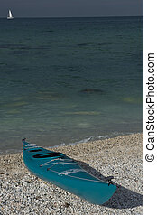 Canoe on the Beach - Green canoe lying on the beach of...
