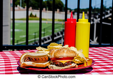 Tailgate Party - Tailgate party with cheeseburger, hot dog,...