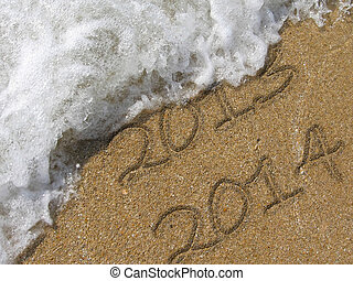 New year 2014 in the sand beach - New year 2014 written in...