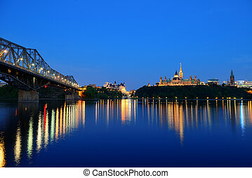 Ottawa at night over river with historical architecture