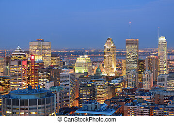 Montreal at dusk with urban skyscrapers viewed from Mont...