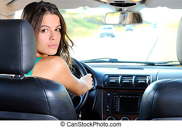 Travelling - An attractive young Caucasian woman looking at...