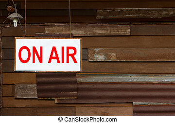 On Air Sign with old wooden wall background
