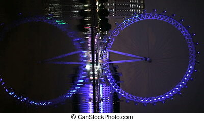 London Eye reflected in the Thames - London Eye reflected in...