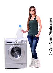 Washing - A pretty young woman doing laundry