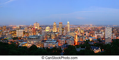 Montreal at dusk panorama with urban skyscrapers viewed from...