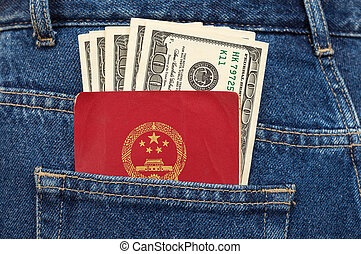 Chinese passport and dollar bills in the back jeans pocket