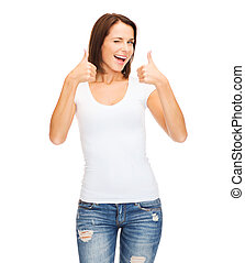 woman showing thumbs up and winking - happy people concept -...