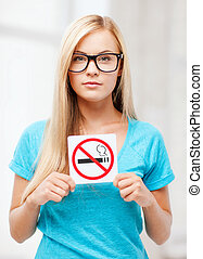 woman with smoking restriction sign - picture of woman with...
