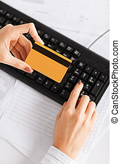 businesswoman with laptop using credit card - business,...