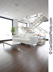 Living room at duplex apartment with sofa and stairs