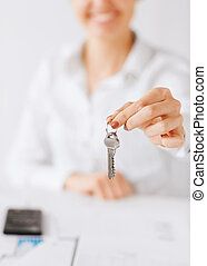woman hand holding house keys - business, banking, real...