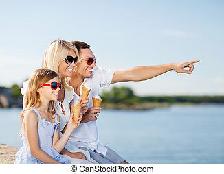happy family eating ice cream - summer holidays,...