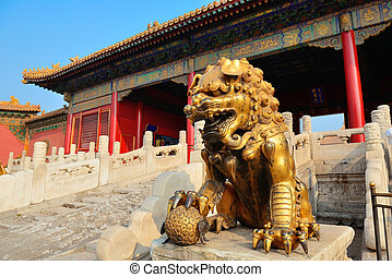 Forbidden City - Lion statue and historical architecture in...