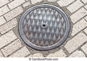 pavement & hatch sewer manhole (see more in portfolio)