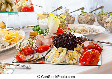 Table full of appetizers - A table with plates with tasty...