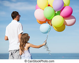 father and daughter with colorful balloons - summer...