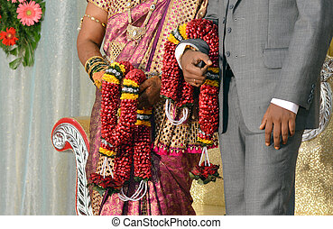Newly married south Indian bride and groom at wedding...