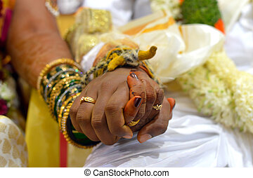 South Indian Marriage couple holding their hands together...