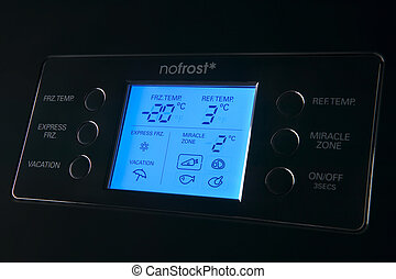 Modern refrigerator display control panel blue tone close up...