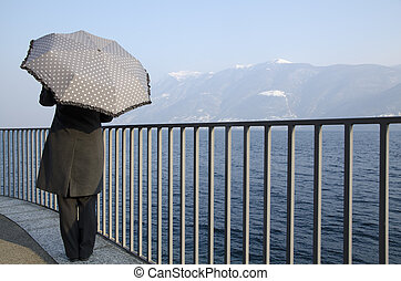 Woman with an umbrella on the lakefront - Woman standing up...