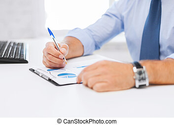businessman working and signing papers - business, office,...