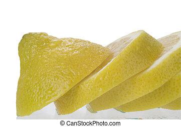 Sliced Lemon Macro - A sliced lemon front of a white...