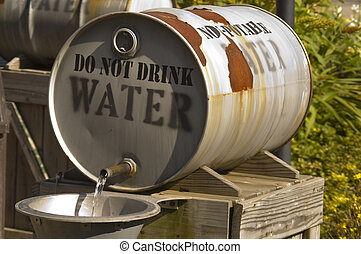 Non Potable - A 55 gallon drum turned on its side with water...