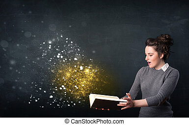 Young lady reading a magical book in front of a blackboard