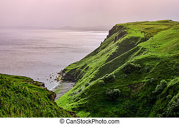 Ocean coastline with green cliffs in Scottish highlands -...