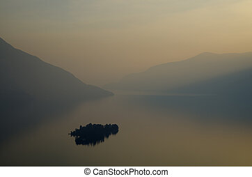 Island on a lake with mountain - Islands on a foggy lake...