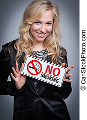 Woman With No Smoking Sign. - Attractive blond women holding...