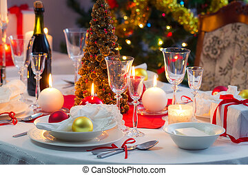 Preparing for Christmas Eve at beautifully decorated table