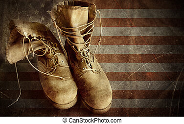 US Army boots on the old paper flag background - US Army...