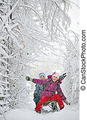 Kids sliding -  Kids sliding in winter time