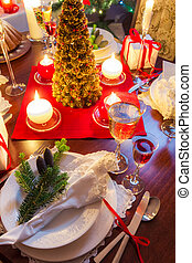 Preparation for dinner at Christmas table