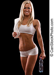 Happy muscle woman with bottle of water - Happy woman with...
