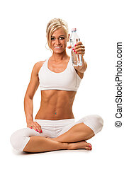Fit a smiling blond woman holding a mineral water - Fit a...