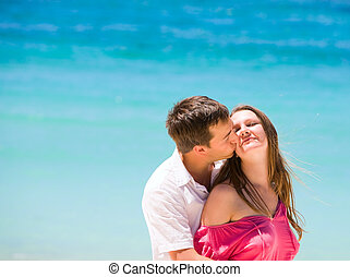 Honeymooners - Portrait of romantic couple kissing in...