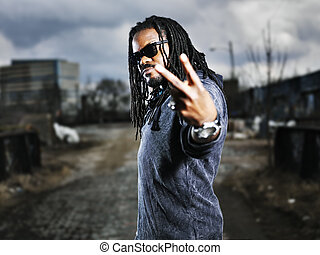 urban african man showing peace sign