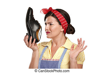 beautiful vintage housekeeper holding a smelly shoes with...
