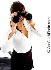 side view of businesswoman looking through binocular