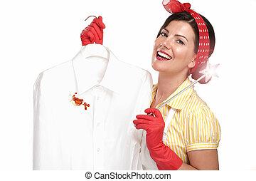 beautiful woman housewife showing a dirty shirt