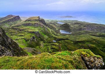 Scenic view of green Quiraing coastline in Scottish...