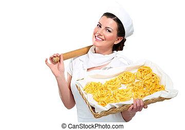 young beautiful woman showing homemade fresh pasta