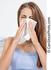 young brunette woman with flu cold influenza