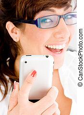 side pose of smiling female holding ipod - side pose of...