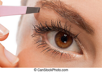 youtg beautiful woman eyebrow plucking tweezers eyes hair...