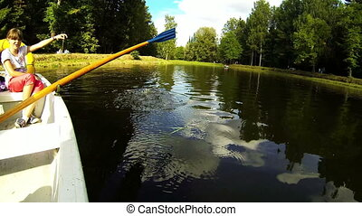 Paddle rowing water